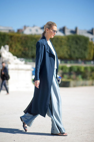 If you're a fan of classic pairings, then you'll like this combination of a navy duster coat and 3.1 Phillip Lim High Waist Wide Leg Trousers. Mix things up by wearing silver leather flat sandals. This ensemble is a foolproof option if you're searching for a great, summer-friendly getup.