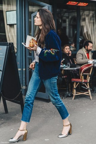 How to wear: navy embroidered bomber jacket, blue fringe jeans, silver leather pumps