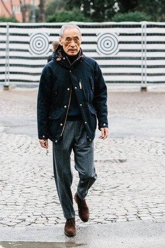 500+ Outfits For Men After 60: Rock a navy field jacket with grey wool dress pants - this look will certainly make a bold statement. Add a more informal twist to this ensemble by rocking a pair of dark brown suede desert boots. This combo proves that figuring out how to dress well at 60 is easier than one might think.