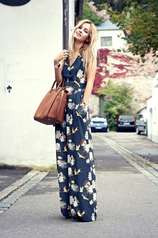 How to wear: navy floral jumpsuit, brown leather tote bag, gold necklace