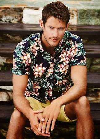 Dress in a navy and white floral shirt and yellow shorts for a comfortable outfit that's also put together nicely.