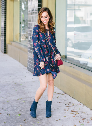 How to wear: navy floral swing dress, teal suede ankle boots, purple leather crossbody bag