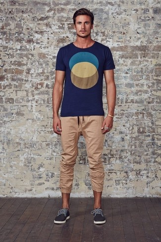 How to wear: navy geometric crew-neck t-shirt, tan sweatpants, charcoal plimsolls