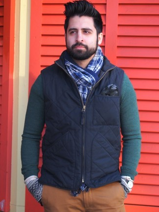 How to wear: navy gilet, dark green crew-neck sweater, tobacco chinos, blue plaid scarf