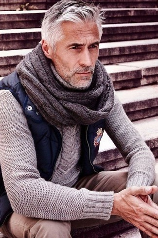 How to wear: navy gilet, grey cable sweater, beige chinos, grey knit tie