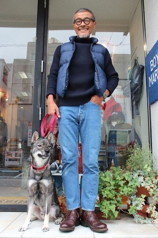 How to wear: navy quilted gilet, navy knit turtleneck, blue jeans, dark brown leather desert boots