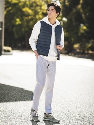 How to wear: navy gilet, white hoodie, grey dress pants, grey suede low top sneakers