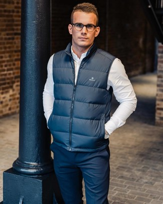 How to wear: navy gilet, white long sleeve shirt, navy chinos