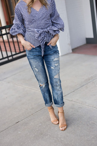 How to Wear Blue Ripped Boyfriend Jeans: Pair a navy gingham long sleeve blouse with blue ripped boyfriend jeans for equally chic and easy-to-wear getup. You know how to smarten up this outfit: tan leather heeled sandals.
