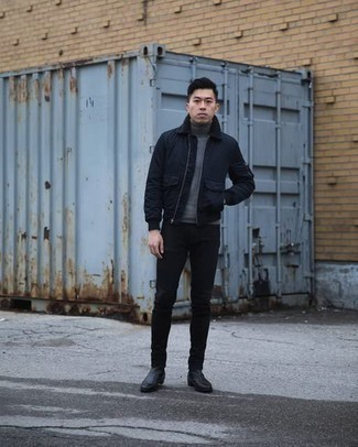 Black Leather Chelsea Boots Outfits For Men: A navy harrington jacket and black jeans are the kind of a winning off-duty look that you need when you have no extra time to pick out an ensemble. Enter a pair of black leather chelsea boots into the equation to switch things up.