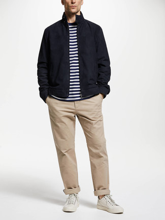 How to wear: navy harrington jacket, white and navy horizontal striped crew-neck t-shirt, beige chinos, white leather low top sneakers