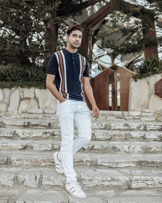 How to Wear a Henley Shirt For Men: A henley shirt and white ripped skinny jeans are great menswear essentials to have in your off-duty repertoire. A pair of white and navy canvas low top sneakers will add a different twist to your ensemble.