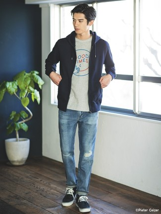 How to wear: navy hoodie, grey print crew-neck t-shirt, blue ripped jeans, navy low top sneakers
