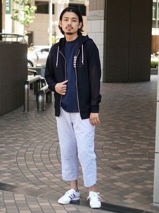 Navy Hoodie Outfits For Men: If you're looking for a laid-back and at the same time dapper outfit, rock a navy hoodie with light blue chinos. Complement your ensemble with a pair of white and red and navy athletic shoes to keep the ensemble fresh.