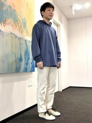 Navy Hoodie Outfits For Men: A navy hoodie and white chinos are the perfect way to inject effortless cool into your current casual routine. The whole ensemble comes together wonderfully if you introduce a pair of yellow canvas low top sneakers to the equation.