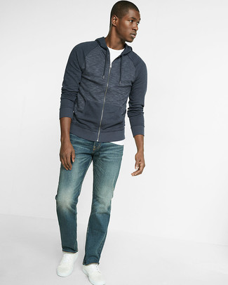 How to wear: navy hoodie, white crew-neck t-shirt, blue jeans, white leather low top sneakers