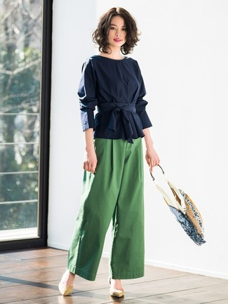 How to Wear Tan Suede Pumps: Go for a navy long sleeve blouse and green wide leg pants to look chic anywhere anytime. Look at how well this ensemble goes with a pair of tan suede pumps.