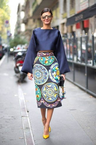 How to wear: navy satin long sleeve blouse, navy print midi skirt, yellow leather pumps, grey sunglasses