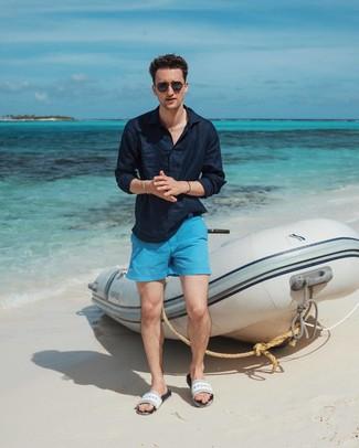 How to wear: navy linen long sleeve shirt, aquamarine shorts, white rubber sandals, black sunglasses