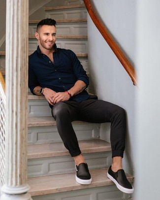How to wear: navy long sleeve shirt, black chinos, black leather slip-on sneakers, black leather watch