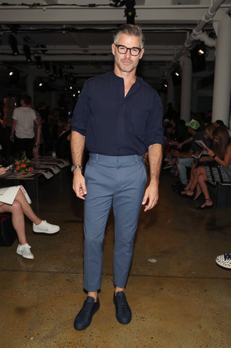 Fashion for Men Over 50: What To Wear: A navy long sleeve shirt and blue chinos are wonderful menswear staples that will integrate brilliantly within your day-to-day fashion mix. Navy leather low top sneakers will give a sense of stylish nonchalance to an otherwise classic getup.