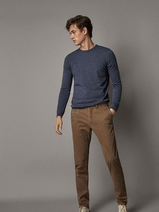 Navy Long Sleeve Shirt Outfits For Men In Their 20s: Marrying a navy long sleeve shirt with brown chinos is an amazing choice for a laid-back ensemble. And if you want to effortlessly tone down this outfit with one single piece, introduce a pair of beige canvas low top sneakers to your ensemble. Great for a 20-something if you want to project a relaxed image.