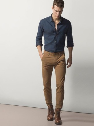 Brown Leather Casual Boots Outfits For Men: If you're in search of a casual yet on-trend outfit, reach for a navy long sleeve shirt and brown chinos. To give your overall look a more sophisticated aesthetic, complement your outfit with brown leather casual boots.