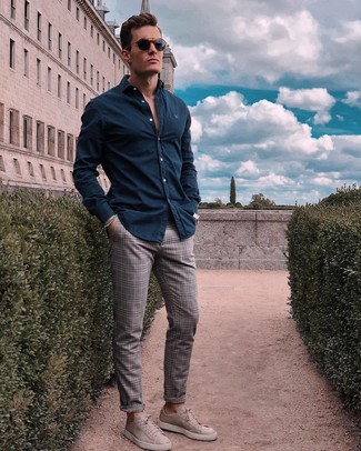 How to wear: navy long sleeve shirt, grey plaid chinos, grey suede low top sneakers, navy sunglasses