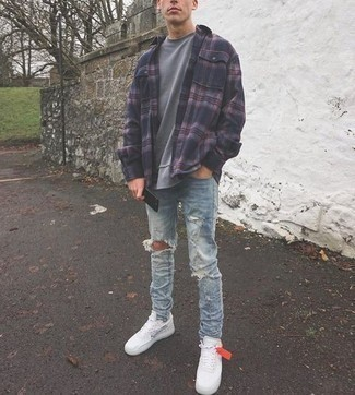 How to Wear Light Blue Ripped Jeans For Men: Choose a navy plaid flannel long sleeve shirt and light blue ripped jeans to be both casual street style and comfortable. You can take a classic approach with shoes and add a pair of white and black print canvas low top sneakers to your ensemble.