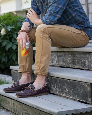 Navy Plaid Long Sleeve Shirt Outfits For Men: This combo of a navy plaid long sleeve shirt and khaki chinos is proof that a pared down casual outfit can still be really interesting. A pair of burgundy leather boat shoes is a savvy pick to complete this outfit.