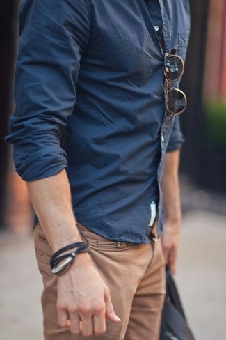 Consider wearing a dark blue long sleeve shirt and khaki casual trousers to bring out the stylish in you.