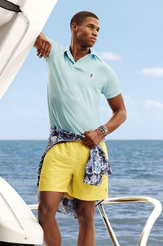 For an everyday outfit that is full of character and personality rock a navy and white floral shirt with yellow shorts.