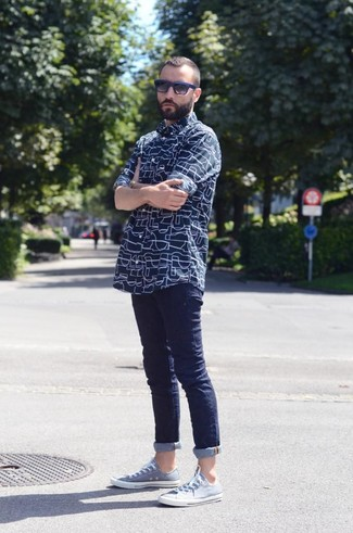 Men's Navy Print Long Sleeve Shirt, Navy Skinny Jeans, Light Blue Low Top Sneakers, Black and Blue Sunglasses