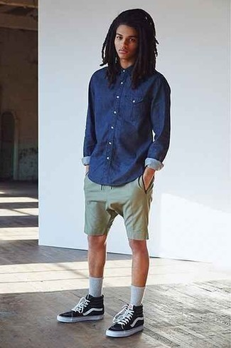 How to Wear Black and White Canvas High Top Sneakers For Men: If the setting permits a laid-back menswear style, wear a navy chambray long sleeve shirt with olive shorts. Up the wow factor of this outfit by wearing a pair of black and white canvas high top sneakers.
