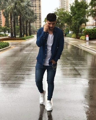 How to Wear White Leather Low Top Sneakers For Men: Teaming a navy long sleeve shirt with navy skinny jeans is an on-point idea for a relaxed look. Add a pair of white leather low top sneakers to the equation for extra style points. After all, when do you pull off casual looks like this if not when you're 20?