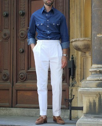Navy Chambray Long Sleeve Shirt Outfits For Men: A navy chambray long sleeve shirt and white dress pants are strong players in any man's wardrobe. Our favorite of a great number of ways to complement this getup is a pair of brown suede tassel loafers.