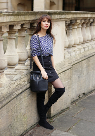 Nail glam in a dark blue horizontal striped long sleeve t-shirt and a button skirt. Got bored with this look? Enter black suede over the knee boots to spice things up. This combination is everything for when leaves are falling down and autumn is in the air.