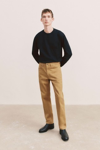 Long Sleeve T-Shirt Outfits For Men: Make a long sleeve t-shirt and khaki jeans your outfit choice for a casual ensemble with a fashionable spin. A pair of black leather chelsea boots immediately elevates the ensemble.