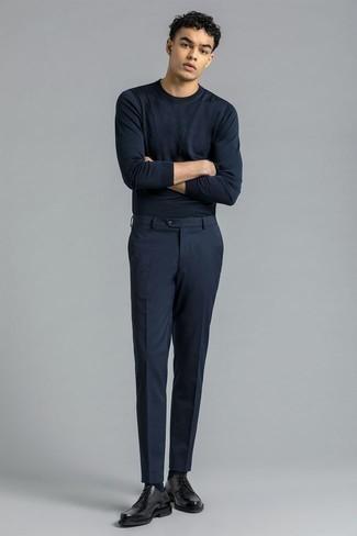 Men's Outfits 2021: This combination of a navy long sleeve t-shirt and navy chinos is hard proof that a straightforward casual look doesn't have to be boring. Smarten up your outfit with a pair of black leather derby shoes.