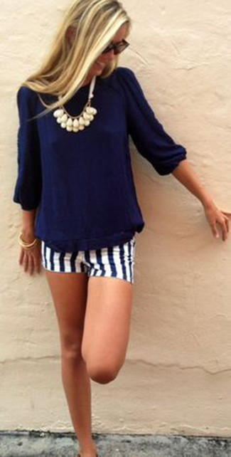 Who said you can't make a style statement with a casual outfit? You can do so with ease in a blue t-shirt and white and navy striped shorts. You know when it's roasting hot outside, sometimes only a proper outfit like this one can get you through the day.