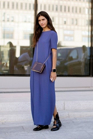 How to Wear a Purple Leather Crossbody Bag: Try teaming a navy maxi dress with a purple leather crossbody bag to put together an interesting and current casual outfit. For something more on the sophisticated side to complete this look, complement your ensemble with black cutout leather ankle boots.