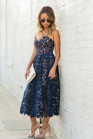 How to wear: navy lace midi dress, beige leather heeled sandals, white leather clutch, dark brown sunglasses