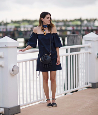 A navy blue off-the-shoulder dress will convey a carefree, cool-girl vibe. A pair of black leather espadrilles looks very appropriate here. There are many ways to look good and survive the extremely hot weather, and that's one of them.