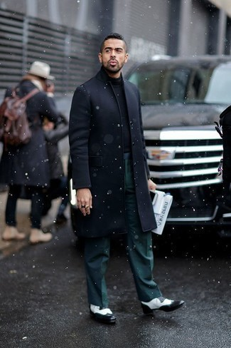 How to Wear Dark Green Dress Pants For Men: A navy overcoat looks so refined when teamed with dark green dress pants. To inject a hint of stylish nonchalance into this outfit, add a pair of black and white leather brogues to the mix.