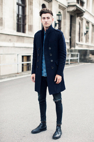 A smart casual combination of a navy blue overcoat and navy destroyed slim jeans can maintain its relevance in many different circumstances. Feeling brave? Complete your look with black leather desert boots.