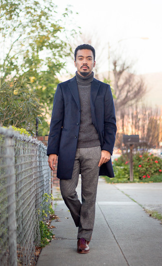 Navy Overcoat Outfits: This pairing of a navy overcoat and grey chinos is truly a statement-maker. If you wish to immediately level up your getup with one item, why not complete this ensemble with a pair of burgundy leather brogues?