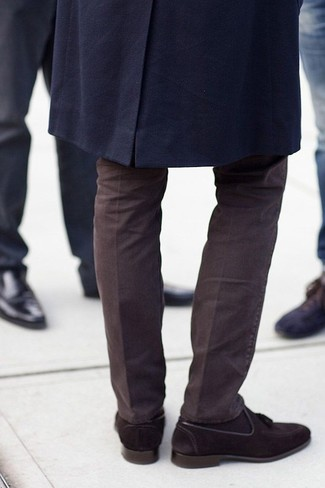 A smart casual combination of a navy overcoat and dark brown chino pants can maintain its relevance in many different circumstances. Dark brown suede tassel loafers are a wonderful choice to complete the look.