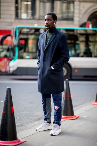 How to wear: navy overcoat, dark green turtleneck, blue sweatpants, grey athletic shoes