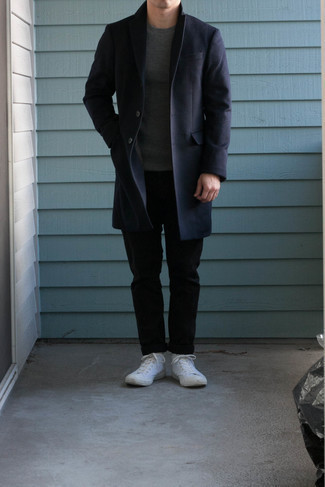 Navy Overcoat Outfits: For a casually sleek look, consider teaming a navy overcoat with black chinos — these items go really cool together. Complete this outfit with a pair of white canvas high top sneakers to make an all-too-safe getup feel suddenly edgier.