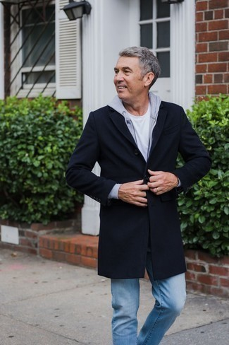 Men's Looks & Outfits: What To Wear In 2020: For an ensemble that's worthy of a modern fashion-forward gentleman and effortlessly smart, wear a navy overcoat and light blue jeans.